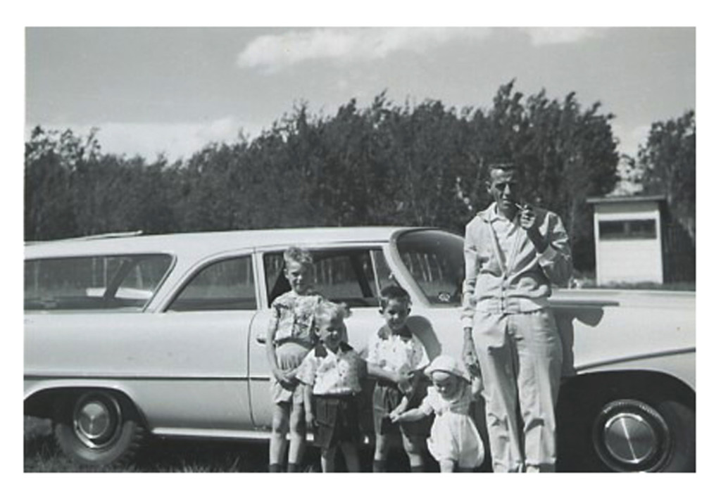 Dad with the boys in front of the new wagon